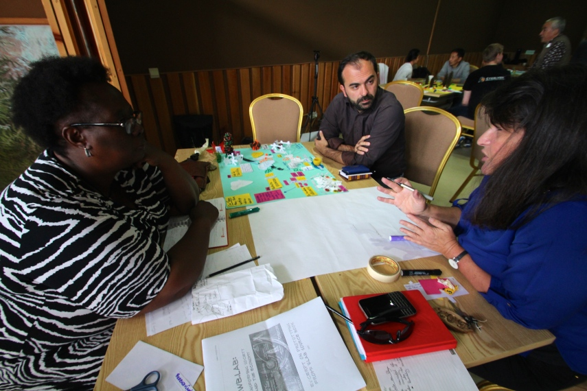 "Members of the South Africa team creating a ""3D model"" of their prototype during the Bhutan Learning Journey"